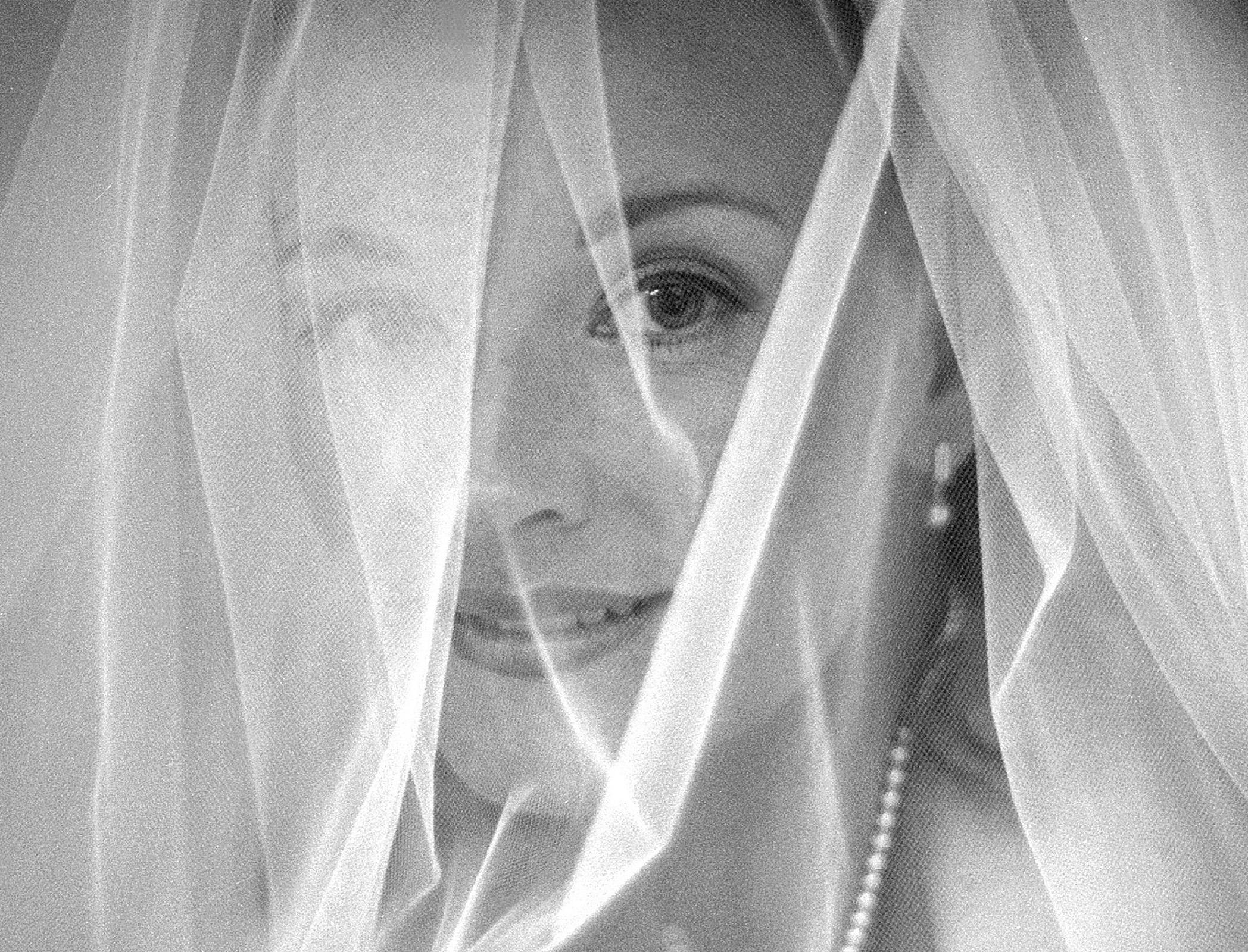 Veiled bride waits in car