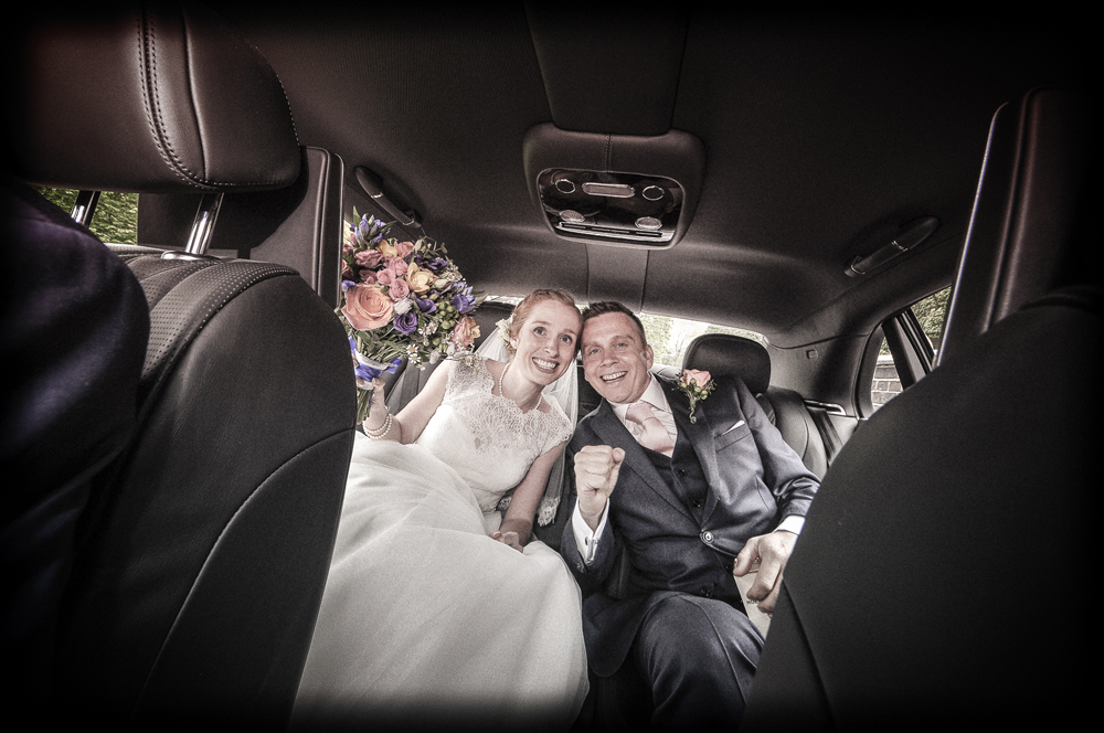 Couple cheer in car