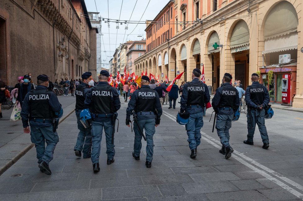 Police men following a 1st of May demonstration in Bologna