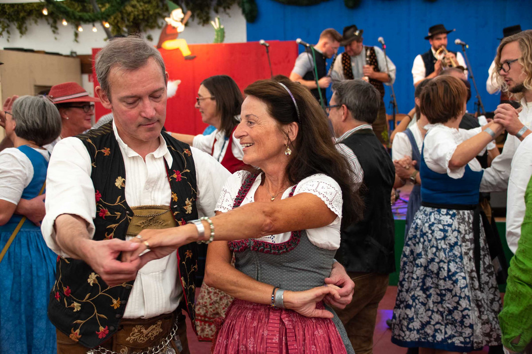 People enjoying traditional dances in the beer tent