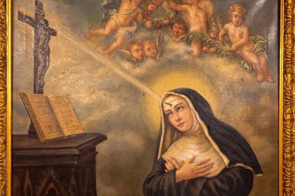Santa Rita receives the stigma. Seen at San Martino church in Bologna.