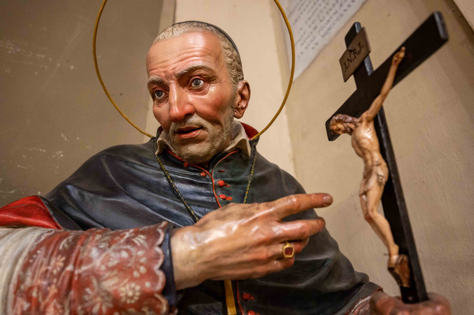 Saint figure at Chiesa San Martino in Bologna