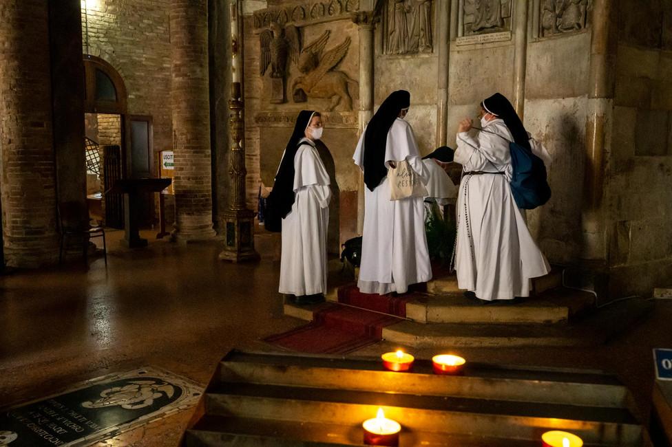 Nuns visiting the Holy Sepulchre at Basilica Santo Stefano in Bologna