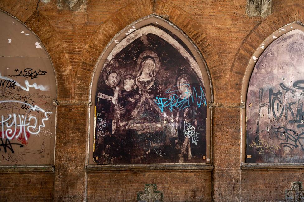 Graffiti under Bologna's porticos