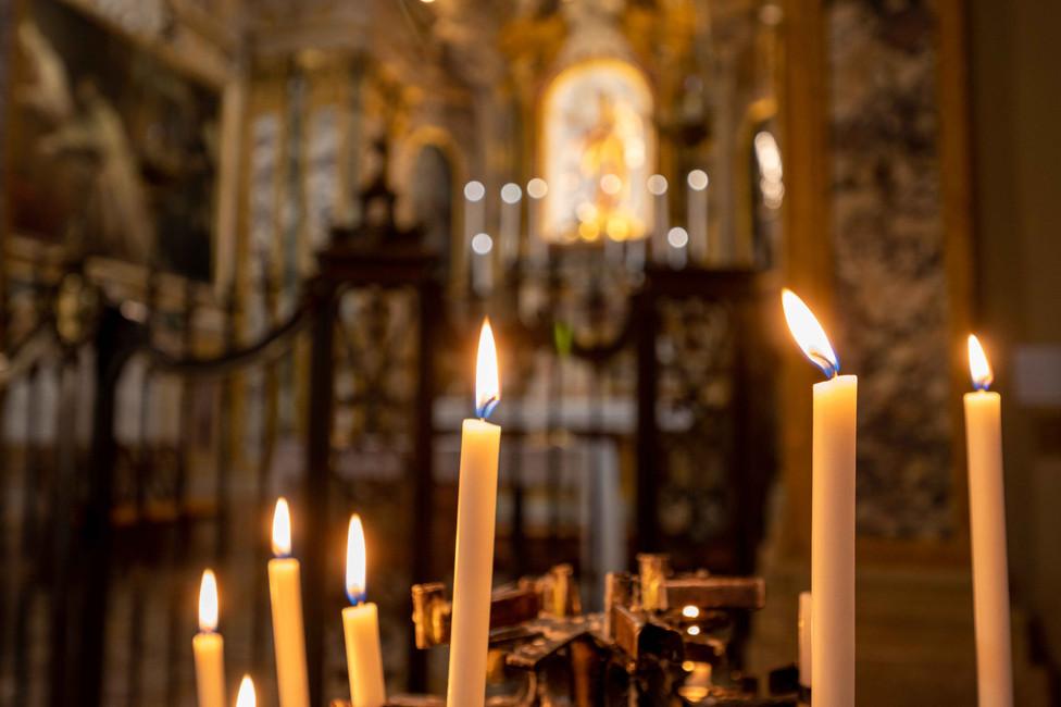candles at San Martino church in Bologna