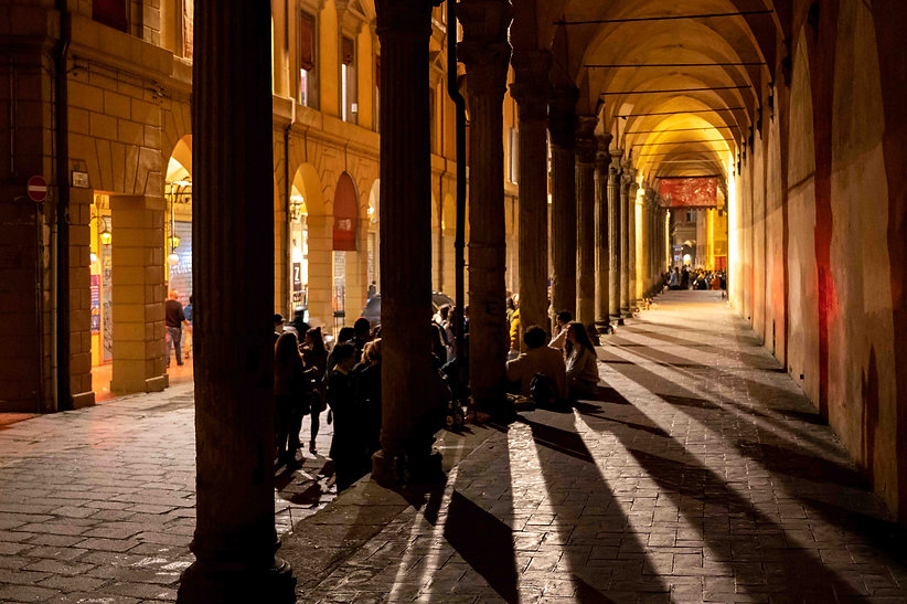 Bologna students meet at night under the portico in Via Zomboni. Light and shadow look pretty at night.