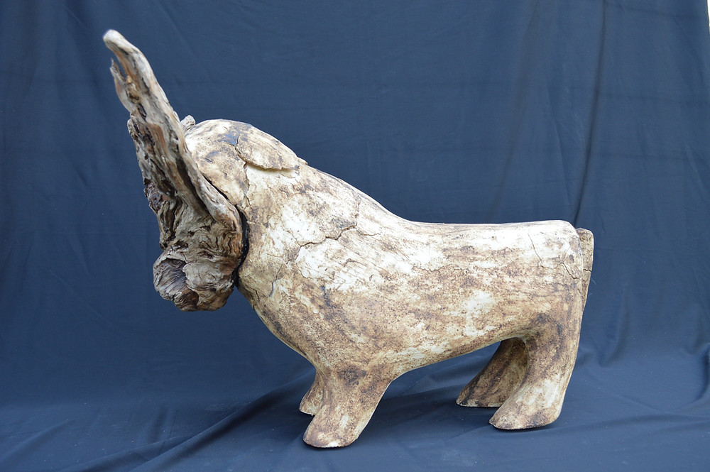 Bison sculpture made of wood and clay