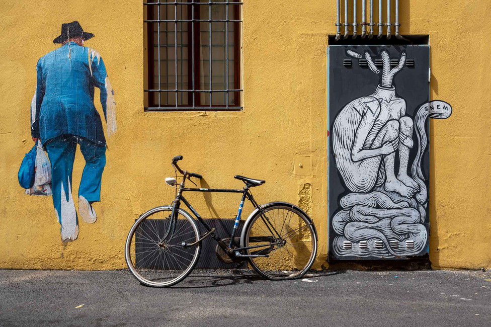 Wall art and a bicycle in Bologna