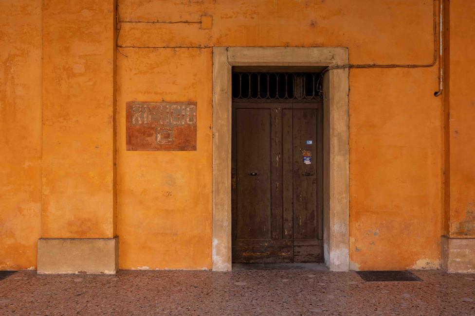 Entrance door in Bologna, street scene