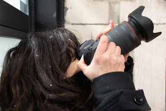 Photographers resisting hail in Siracusa