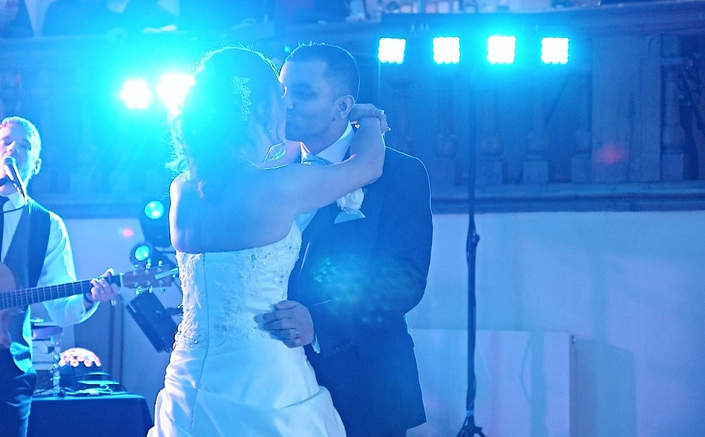 Couple kissing in their first dance