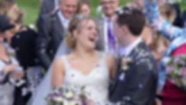 wedding videographers still of bride an groom happy with confetti at tudor barn