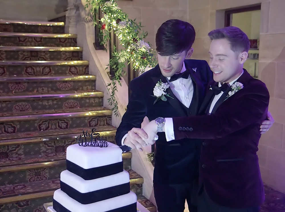 Gay marriage cutting cake