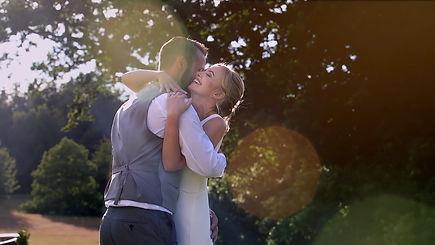 bride and groom hugging whislt being filmed by a surrey wedding videographer