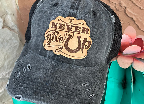 Never Give Up Leather Patch Ponytail Trucker Hat