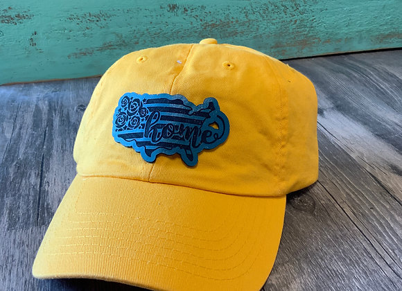 Home USA Shaped Turquoise Leather Patch on a Yellow Vintage Trucker Hat