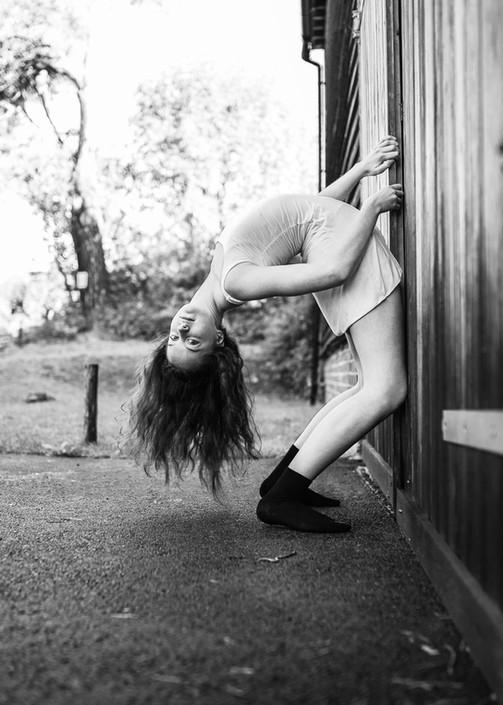 teenage girl backbend barn