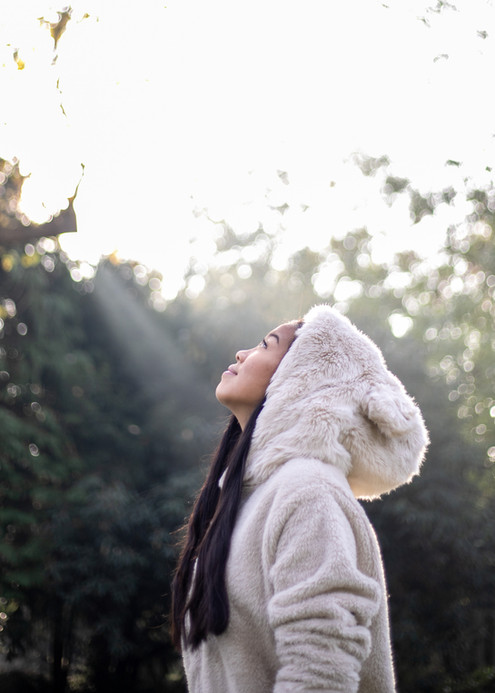 Side profile portrait of teenage girl caught in sunray