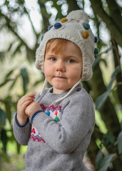 toddler boy in woolly hat and christmas jumper