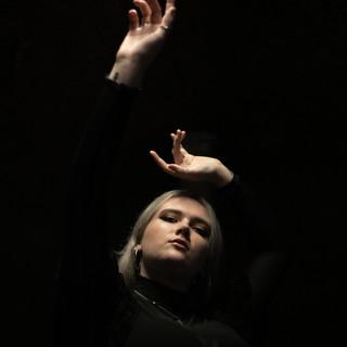 Dark background portrait with hands