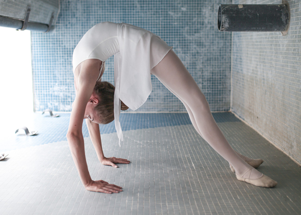 girl dancer in bridge backbend