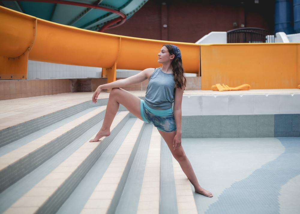 girl posing on steps swimming pool