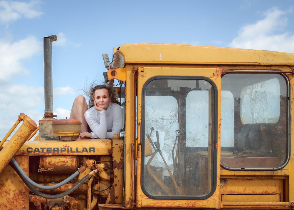 girl posing on yellow digger