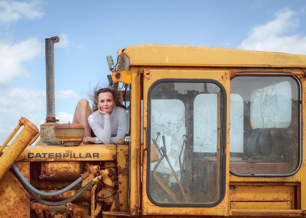 Girl on yellow digger
