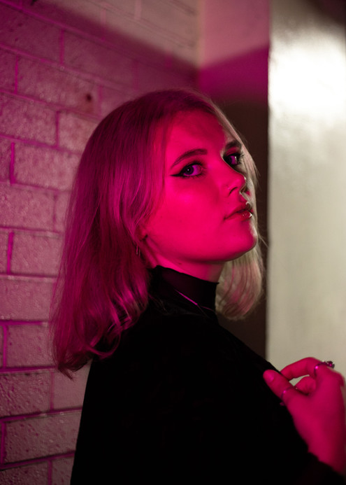 pink light portrait of female musician
