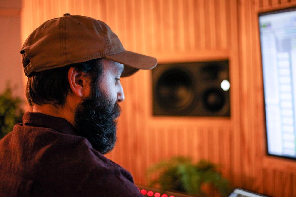 portrait of male mixer beard cap