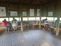 Four young people in bird hide