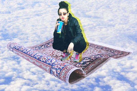 Magic carpet-flying above clouds