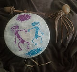 Drum elk rattle and beater.jpg