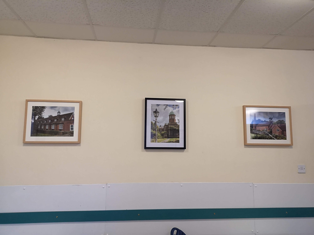 Three photographs on the wall of the Coffee Lounge