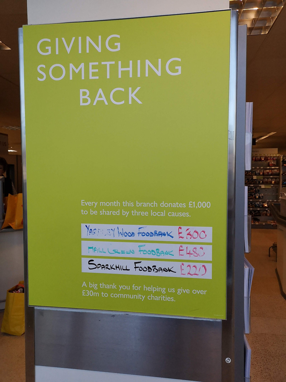 The board at Waitrose Hall Green showing £480 is being donated to the foodbank at the Job Marston Centre