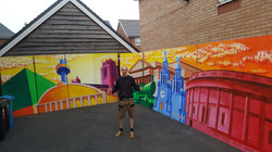 Paul Curtis with his Mural for Danny Boyle