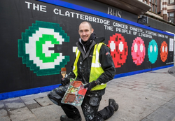 Paul Curtis with Pacman Mural