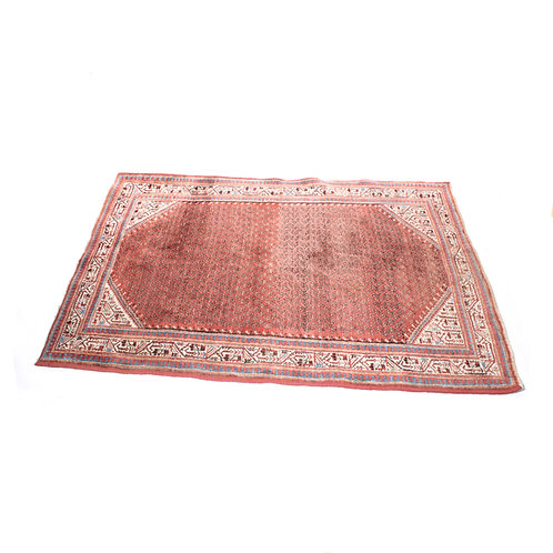 Persian rug with a fantastic worn patina. Hand knitted