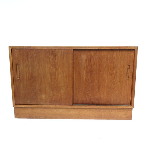 Retro Danish oak cabinet from the 1970s with sliding doors one drawer