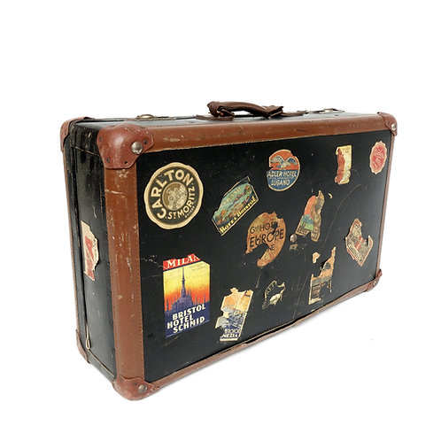 Authentic Vintage mid-century suitcase with plenty of stickers from Europe
