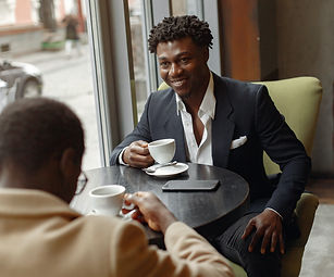 positive-businessmen-having-cup-of-coffe