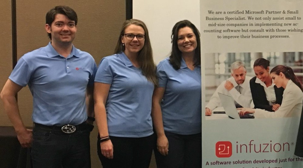 Jon McKinnon of Knoxville working with Corrie Olson and Jami Sugg at an event sharing Infuzion software to wine and spirits wholesalers and distributors