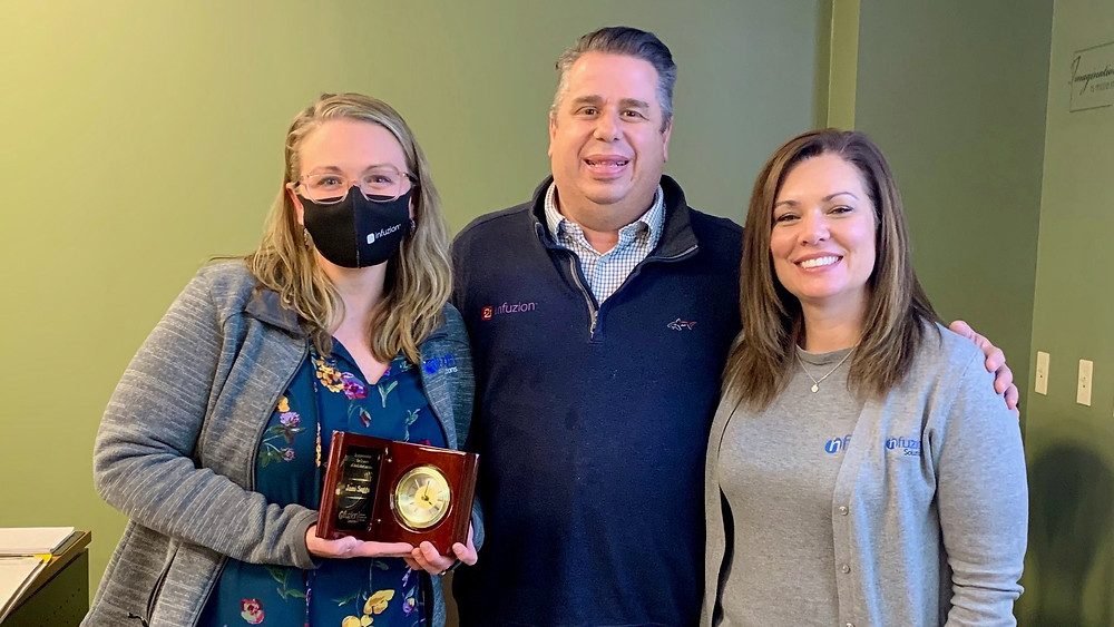 Jami Sugg with Toby and Corrie Olson after receiving an award for her service of 5 years to Infuzion Solutions in Knoxville, TN