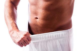 Man-looking-inside-his-shorts.jpg