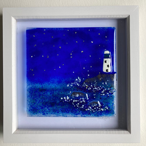 Framed lighthouse at night