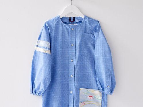 Blouse d'écolier à carreaux et poche village - Bleu