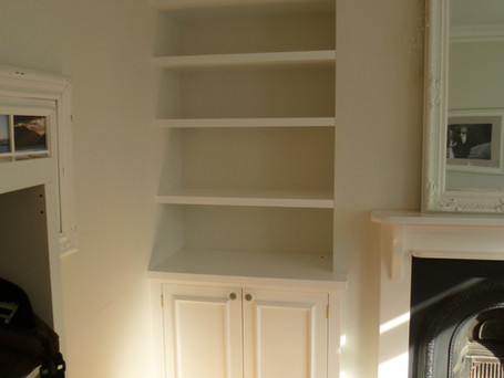 Floating shelves with cabinet below