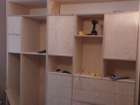 Birch ply storage wall with exposed edges
