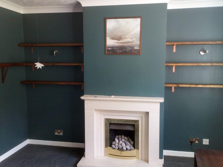 Reclaimed shelving on copper brackets