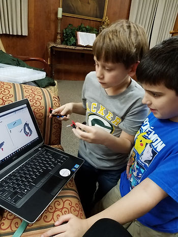 Two boys working on code
